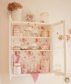 pretty little hanging #cupboard backed in #rosy #wallpaper