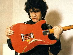 Gary Moore with his '61 Salmon pink strat which was stolen And later returned.  Moore thought one of the British customs people must have stolen it.  It was put on the Interpol computer,and then once the FBI were looking for it, it suddenly reappeared in Houston, in the hold of an aircraft.