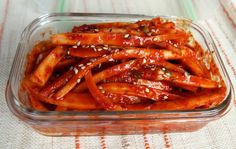 Spicy bellflower root side dish | 3 ounces of dried bellflower roots, ¼ cup hot pepper paste 3 Tablespoons of hot pepper flakes, 1 Tablespoon of soy sauce, 2 Tablespoons of rice or corn syrup 1 Tablespoon of sugar ½ teaspoon of salt 3 Tablespoons of white or apple vinegar 2 stalks of green onions,  2 garlic cloves,  1 teaspoon of sesame seeds 2 teaspoons of sesame oil