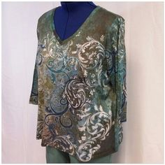 """AVENUE Rhinestones Paisley Floral Abstract 18/20 AVENUE Rhinestones on Paisley Floral Abstract designed pattern top, size 18/20, 3/4 sleeves, v-neck, straight hem, machine washable, 100% polyester,  27"""" length shoulder to hem, 24"""" bust laying flat,  18"""" sleeves, 17 3/4"""" width shoulder seam to shoulder seam Avenue Tops"""