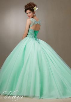 Quinceanera Dress  Vizcaya Morilee 89063  Embroidery and beading on the tulle skirt  *Removable Keyhole Coverlet*  Colors: Scuba Blue, Cotton Candy, Mint and White  A back side view