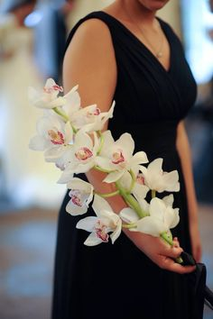 Adam Leffel Productions Bridal Couture. A new take on bouquets for your girls! Use a beautiful stem of cymbidium orchids instead of a typical bouquet!