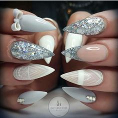 Grey and white stiletto nails with rhinestones and glitter