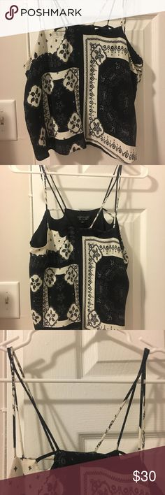Topshop sleeveless black and white top! Topshop black and white patterned sleeveless top. Double spaghetti straps, loose fit, shorter in length. Size 8, only worn a few times! Topshop Tops Tank Tops