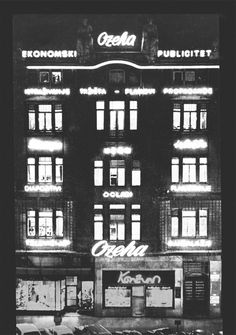 Ozeha building on main squere in Zagreb, Ban Jelačič Squere, pictured at night by Ozeha photographer Milan Klisović, early seventies. Titles on the displays describe what works full service agency: market research, marketing planning, print and TV advertising, outdoor advertising, photography, exhibition, packaging, publicity ...