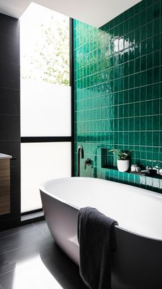 House call: Step inside Janes modern and edgy Australian design home. Vertical stack subway tile in bathroom green crackle glaze subway tile green tile feature wall in bathroom Bathroom Interior Design, Decor Interior Design, Interior Design Living Room, Bad Inspiration, Bathroom Inspiration, Bathroom Ideas, Appartement Design, Beautiful Bathrooms, Tile Design