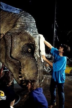 A T-Rex getting a make-up touch up behind the scenes on #JurassicPark (1993)