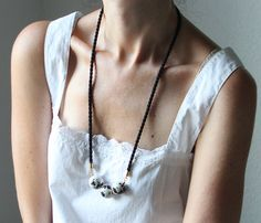 Necklace + simple shirt with killer neckline