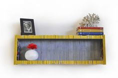 colorful shelf  made entirely from recycled National Geographic magazines