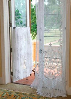 What a beautiful way to cover double doors, but still see out, LOVE~❥ and the curtain is divine
