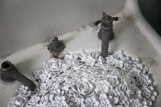 Bathroom Fixtures at Alcatraz Transformed into Porcelain Floral Bouquets by Ai Weiwei http://www.thisiscolossal.com/2014/11/ai-weiwei-alcatraz/