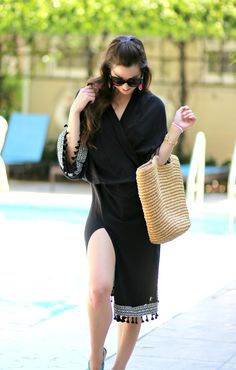 This black kimono from the new H&M Loves Coachella collection is perfection! It's comfy, has high leg slits, and features Aztec print trim and adorable black tassels (yasss).