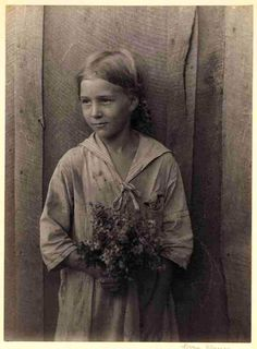 Silver Gelatin Print c.1925-34 Young girl in sailor-collared dress, holding bouquet of wildflowers. Doris Ullman @ Kentucky Digital Library