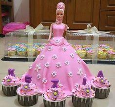http://renilim.hubpages.com/hub/Barbie-Birthday-Cake-and-Cupcakes