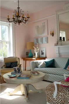 Funky Bergere chair, crazy patterns, Hollywood regency I think - love the subtle silhouettes below the not so subtle sheep art. I think I'd find something else as that pic. Again pink surprises me. Not a room I would expect to be the family hang out room.