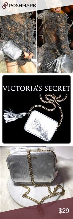"""Victoria Secret Fashion Show Cross-body Bag NWT Victoria's Secret Official Fashion Show Bag. Fashion Show Limited Edition Brand new with tags in packaging. Color silver with gold chain strap and VS logo Approx measures 7.5"""" L x 2"""" W x 6"""" H Along with bag included is a VS shopping bag and the VS tissue paper. PINK Victoria's Secret Bags Crossbody Bags"""