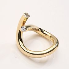 Jytte Kløve: A diamond ring set with two brilliant-cut diamonds weighing a total of app. 0.57 ct., mounted in 18k gold.  www.kloeve.dk