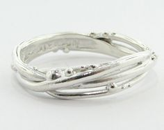{Artisan jewelers creating hand crafted; unique and one of a kind rings, pendants and earrings. From engagement, fashion or any occasion.}
