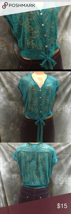 Teal lace top ⚡️SALE⚡️ Beautiful lace top in color teal , new without tags and never worn . It's see through so you have to wear something under or nude bra . Shows a little tummy unless you wear a cami under . Size M Agaci Tops Blouses