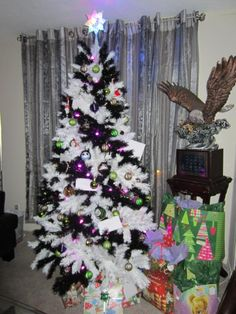 The black and white Zebra Striped Christmas tree is the perfect backdrop for purple and green ornaments