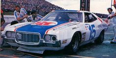 Buddy Baker -- Around this time Buddy Baker set speed records that lasted nearly 20 years while working as a test driver from Chrysler!