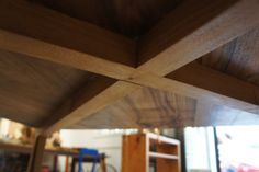 Under a square walnut table