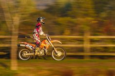 Used panning with a slow shutter speed to capture motorcyclist in motion