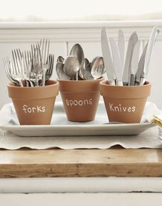 Silverware Display    Set silverware out in pretty terra-cotta pots. Label each container using chalk, so you can wipe off the writing and reuse the pots.      Read more: Party Planning Ideas - Party Tips - Country Living