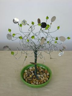 sculpture wire tree with green glass beads & round small mirror on a ceramic plate. $45.00, via Etsy.