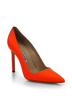 Manolo Blahnik Nappa Neon Leather Point Toe Pumps.  The neon pink is smoking.  I will look super hot in the poorhouse!