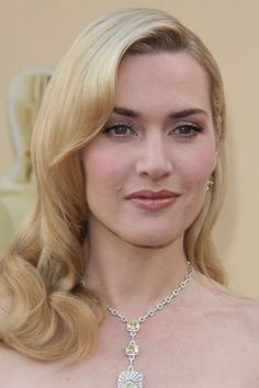 Kate Winslet wearing a long sleek elegant side swept hairstyle