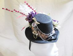 Steampunk Fascinator Hat in Black with Purple Green Red Beige silk flowers Vintage jewelry feathers Lace chains romantic costume Halloween. $65.00, via Etsy.