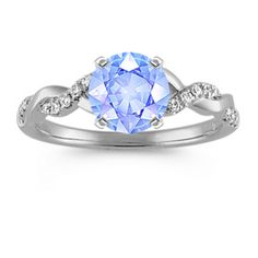 Round Diamond Infinity Engagement Ring in 14k White Gold with Round Ice Blue Sapphire