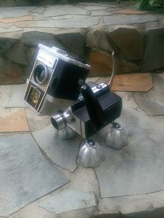 Tinbot Robot Dog. Made from vintage cameras and jello molds.