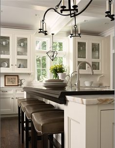 Beautiful kitchen, I like the miss of glass cabinets and the bottoms of the cabinets