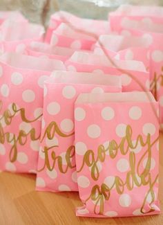Pretty gold writing on pink polka dots for favor bags. I like this look for other paper projects too, like a scrapbook page.