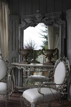 atelier de campagne-blog I like the shutters added to sides of mirror!
