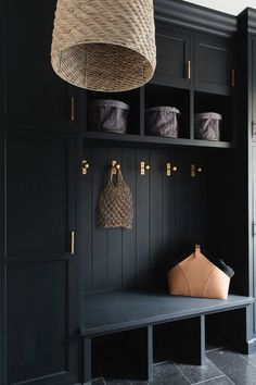 A mudroom entryway is taken to the next level with sumptuous black paint and brass hardware, while linen, leather and woven accents lend a lived-in warmth. Mudroom Laundry Room, Laundry Room Design, Utility Room Designs, Hallway Designs, Home Projects, House Design, Interior Design, Brass Hardware, Entrance