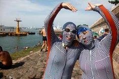 """""""Face-Kini"""" Full Body Bathing Suits Flaunted by Fashionable Chinese Swimmers    ---  from InventorSpot.com --- for the coolest new products and wackiest inventions."""