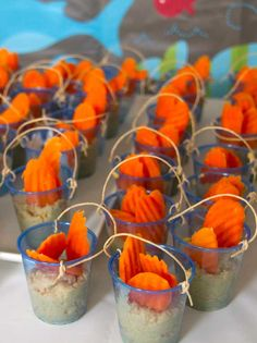 Adorable presentation!  Mini plastic cups (Target often carries these) with hummus and crinkle-cut carrots.