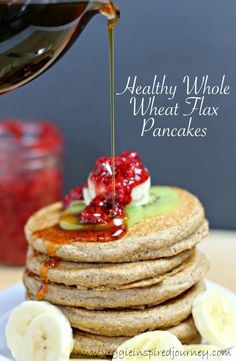 Healthy Whole Wheat Flax Pancakes - delicious and easy pancakes just beginning for a topping of fresh fruit and a drizzle of pure maple syrup!
