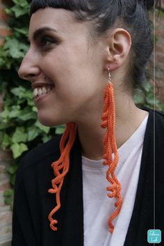 "I designed and crocheted this pair of earrings with an embroidery thread 100% cotton made in Italy. This accessory has a funny and changeable shape, enjoy playing with curls! You can wear it with casual or elegant clothes adding a colorful touch of originality to any outfit. Available in 20 shades! Length: about 20 cm / 8"" Weight: about 5 gr each / 0,03 lb each Color: carrot"