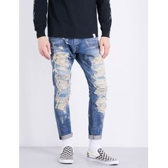 Magic Stick Destroyed loose-fit tapered jeans (€705) ❤ liked on Polyvore featuring men's fashion, men's clothing, men's jeans, mens destroyed jeans, mens slim fit tapered jeans, mens ripped jeans, mens cropped jeans and mens zipper jeans