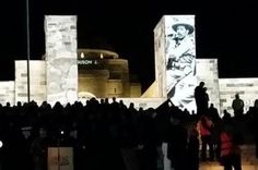 Tens of thousands stand in silence at the Dawn Service in Canberra