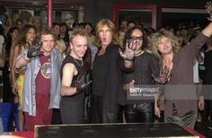 Left to right, Rick Allen, Phil Collen, Joe Elliot, Vivian Campbell and Rick Savage of Def Leppard pose for photgraphers after their induction to the Rock Walk of Fame at the Guitar Center September 5, 2000 in Hollywood, California.