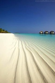 Crystal clear waters with fine white sand beach in Maldives