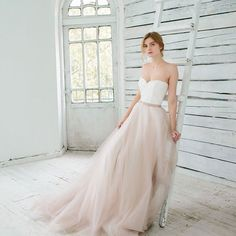 This delicious dress by @ca.rousel_official is perfect for the elegant bride who wants to keep things classic with an on trend twist. But wait there's more… This dress is actually a two piece, yep the tulle skirt whips off to reveal an off-white chiffon and satin underskirt (now THAT would be a great first dance party trick!). Find out more at www.paperandlace.com (or link in profile)