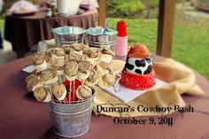 My cowboy party creation for my son, was a blast! Burlap, bandana's, cowboy hats, galvanized buckets (for tea and lemonade), S'mores On A Stick (jumbo marshmallows dipped in chocolate with crushed graham crackers and toffee pieces), add a cowboy cake and BAM! you gotta a kickin' giddy-up party.
