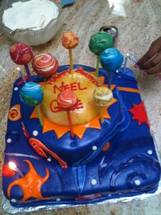Hard to capture in a picture.  It was a three dimensional solar system cake.  Sun in the middle and planets rotating.