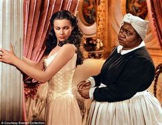 "E o vento levou. from - Vivien Leigh and Hattie McDaniel in the film ""Gone with the Wind."" Vivien Leigh won a best leading actress Oscar for the role of Scarlett O'Hara and Hattie McDaniel won the best supporting actress Oscar for the role of Mammy. Vivien Leigh, Hattie Mcdaniel, Black Actresses, Scarlett O'hara, Go To Movies, Oscar Winners, Gone With The Wind, Bridesmaid Dresses, Wedding Dresses"